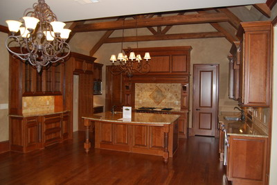 Coffered ceiling and stone fireplace vaulted keeping room with - Whitehurst Santoro Properties Home Detail